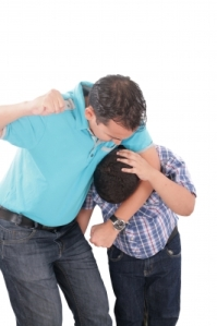 Dad punching kid