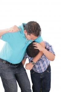 Dad punching kid