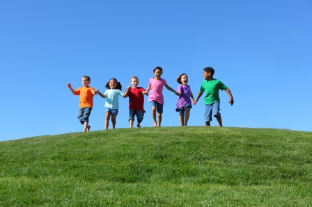 Kids running in field-Shutterstock