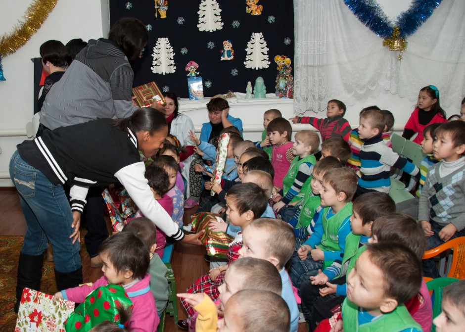 Service member volunteers from the Transit Center at Manas hand out presents to children at the Belovodski Preschool Orphanage in Karabalta, Kyrgyzstan, Dec. 27, 2012. The orphanage houses more than 70 children between the ages of 3 and 7. (U.S. Air Force photo/Tech. Sgt. Rachel Martinez)