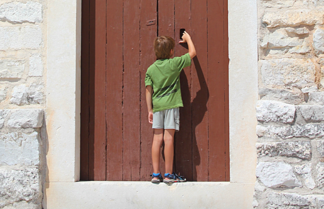 Boy at Church Door