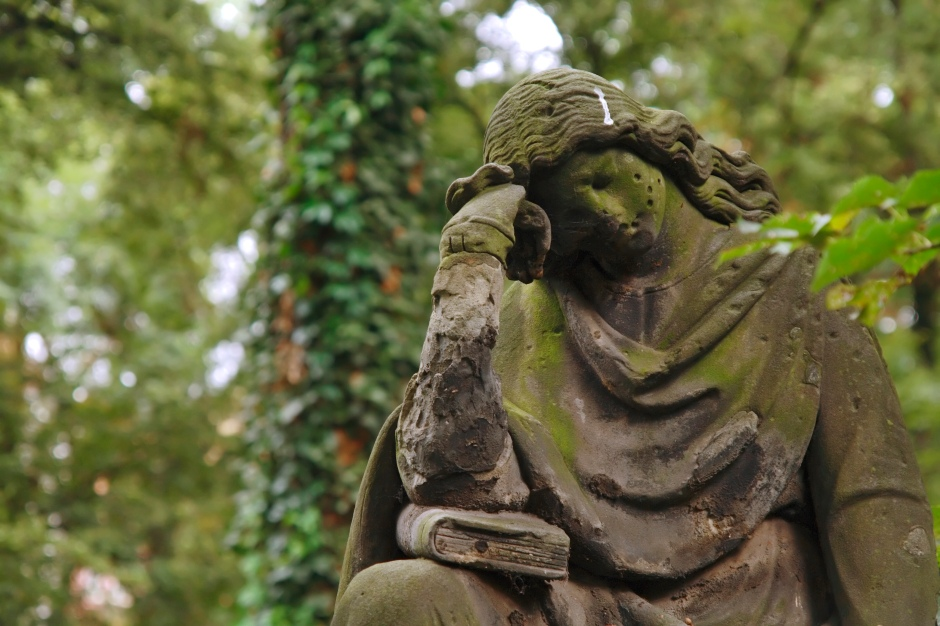 A sculpture of the mourning woman. Old graveyard.